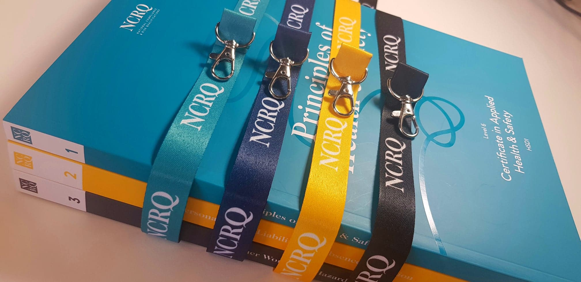 NCRQ lanyards and workbooks